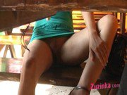 Horny Zuzinka is fingering herself in public at a bar