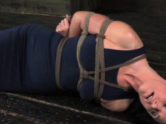 Hogtied sub has belt tied around her neck