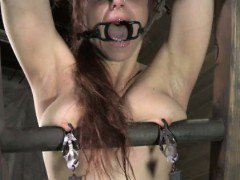 Ginger sub gets spanked while tied and punished with clamps
