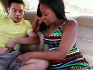 Ebony cutie sucks it in car