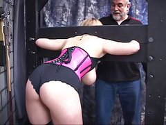 Blonde in pink teddy has her wrists and neck bounded