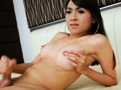Gorgeous busty tranny Sweet A jerks off cock on the bed