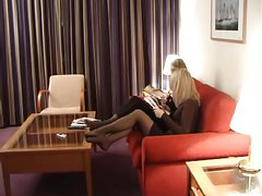 2 lady relaxes feet in black pantyhose 1