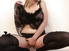 Curvy young blonde looks stunning in sexy lace and stockings