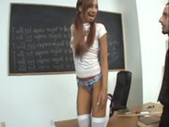 Pigtailed redhead in opaque stockings fucked on a desk