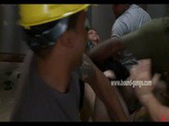 Redhead gets tied down by horny construction workers who have their way with her