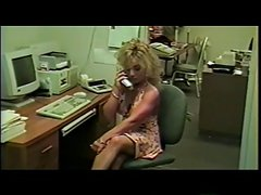 Sexy blonde girl loves to fuck herself in the office with a big white dildo