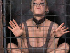 BDSM sub Darling in cage deepthroating