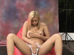 Blonde shemale babe playing with her ass and cock