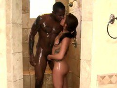 Brunette babe gives nuru massage to a horny black thug