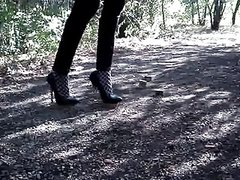 Walking and bending 6 inch silver heels in hoods