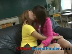 Two hot asian babes kissing