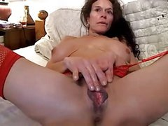 Wife with large pussy lips plays with clit, hubby fingers