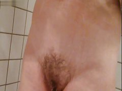 Unaware wife showering. Boobs swinging.