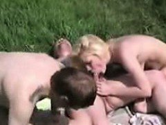 outdoors Swingers Foursome in a meadow