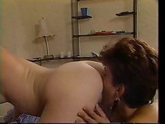 Brunette lesbians licking each other on the bed
