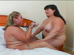 Blonde and Asian BBWs in hot lesbian action