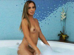 Hot ass shemale goes naked and play with her dick in the tub