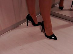 Teasing with high heel shoes and nylon legs