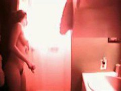 Hot busty teen caught in the shower on hidden cam