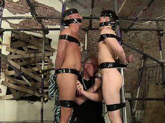 Two boys full of cum and tied to a scaffolding