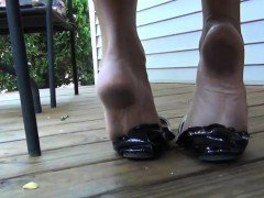 Dangling Her Used Black Shoe Outside