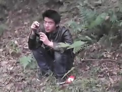 asian convinced to jerk off in the woods