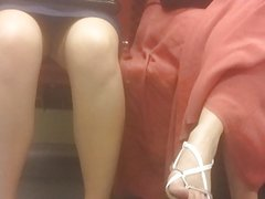 Chick with opened leg upskirted on metro w face shot