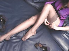 On bed with rht nylon stockings
