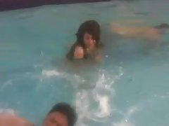 Desi girl enjoyed by her colleagues in pool.