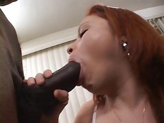 Slutty red head tries to suck thick black thugs cock