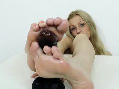 Blondie Bella Karina plays with her legs and foot