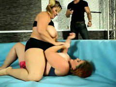 Nude wrestling match between 2 fat and big-titted women