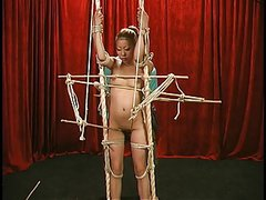 Gorgeous young asian with perfect tits gets restrained by bdsm dungeon master