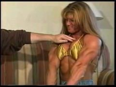 Punching Michelle's pecs and biceps really hard... No way he can hurt her!