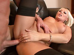 Stunning blonde in stockings gets hard doggy style fuck