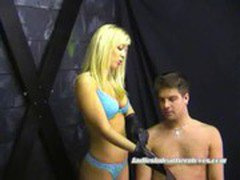 Blue Belle in leather gloves teases slave