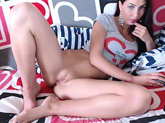 Slender brunette with sexy long legs drills her ass with a