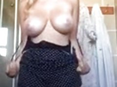 Big tits blonde stripping in her bathroom