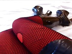 Rubberdoll Monique - sexy legs (hooker boots & fishnet)
