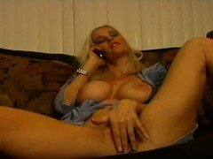 Blonde milf gets horned up during phone conversation