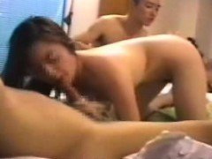 Attractive Japanese girl hooks up with two boys for a wild