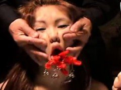 Asian hottie is tied up and gets her face groped and mouth