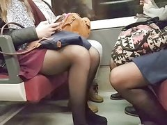 Blonde in sheer black pantyhose in metro