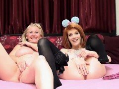 Blonde milf plays with a redhead teen