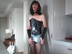 Black PVC bustier and denim shorts cum job