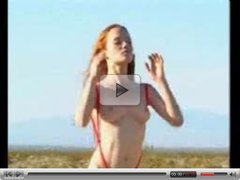 topless busty redhead in thong slingshot masturbating in middle of desert