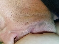 Baby girl breast feeds a daddy