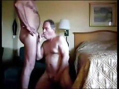 Two older men sucking each other