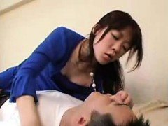 Seductive Japanese girls sharing passionate kisses with the